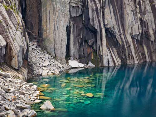 Submerged Boulders, Lake, and Cliffs - photograph by G Dan Mitchell
